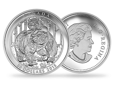 A fine silver coin depicting a family of grizzly bears.